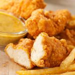 Our golden crispy tender chicken strips are always a hit at kid parties